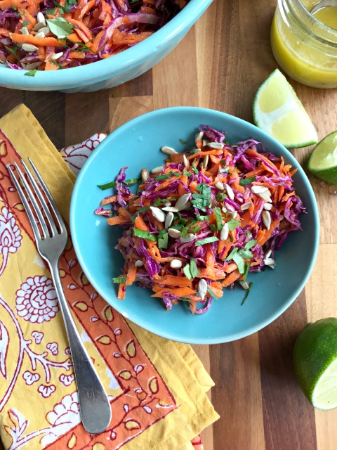 Crunchy carrot-cabbage slaw with maple-mustard vinaigrette is an all-season salad that goes well with all sorts of dishes and looks lovely on a plate.
