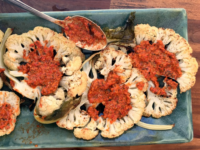 Pumpkin seed Romesco sauce served on roasted cauliflower steaks makes vegetables the star of the meal.