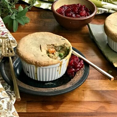 Easy chicken pot pie with cornmeal sage pastry is filled with vegetables and topped with a one-bowl pastry, they're true comfort food on a chilly night.