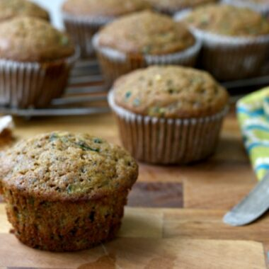 Mom's Lemony Zucchini Muffins Recipe: These moist zucchini muffins are extra lemony and get extra flavour from a little molasses. The recipe works well using half whole wheat flour.